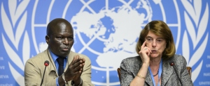 "Member of the Commission of Inquiry on the 2014 Gaza conflict Doudou Diene (L) gestures next to Chairperson of the Commission Mary McGowan Davis during a press conference to present their report on June 22, 2015 at the United Nations Office in Geneva. Both Israel and Palestinian militants may have committed war crimes during last year's Gaza war, a widely anticipated United Nations report said on June 22, decrying ""unprecedented"" devastation and human suffering.   AFP PHOTO / FABRICE COFFRINI"