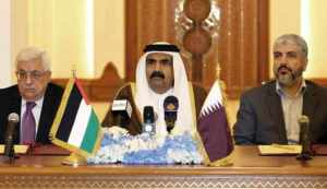 Qatari Emir Sheikh Hamad Bin Khalifa Al-Thani (C) Palestinian President Mahmoud Abbas (L) and Hamas leader Khaled Meshaal attend a ceremony in Doha, on February 6, 2012. Abbas will head an interim national consensus government under a deal signed in Qatar between Abbas and Meshaal , ending a long-running disagreement that had stalled Palestinian reconciliation. AFP PHOTO/STR (Photo credit should read -/AFP/Getty Images)
